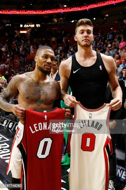 Damian Lillard of the Portland Trail Blazers exchanges jerseys with Meyers Leonard of the Miami Heat after the game at American Airlines Arena on...