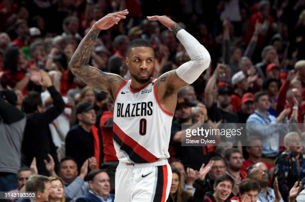 Damian Lillard of the Portland Trail Blazers fires up the crowd during the second half of Game Two of the Western Conference quarterfinals against...