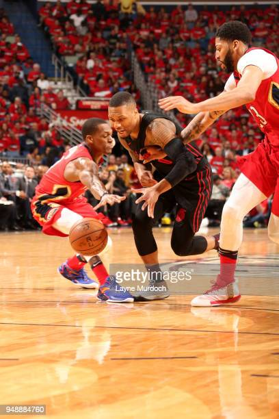Damian Lillard of the Portland Trail Blazers goes after the ball during the game against the New Orleans Pelicans in Game Three of Round One of the...