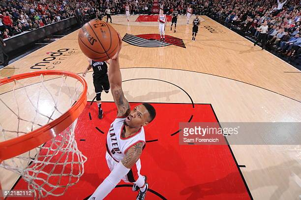 Damian Lillard of the Portland Trail Blazers goes for the dunk during the game against the Brooklyn Nets on February 23 2016 at the Moda Center Arena...