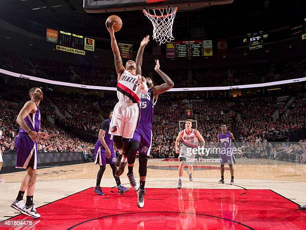 Damian Lillard of the Portland Trail Blazers goes for the layup against the Sacramento Kings during the game on January 19 2015 at Moda Center in...