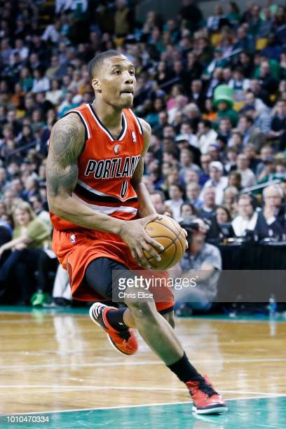 Damian Lillard of the Portland Trail Blazers goes to the basket against the Boston Celtics on November 30 2012 at TD Garden in Boston Massachusetts...