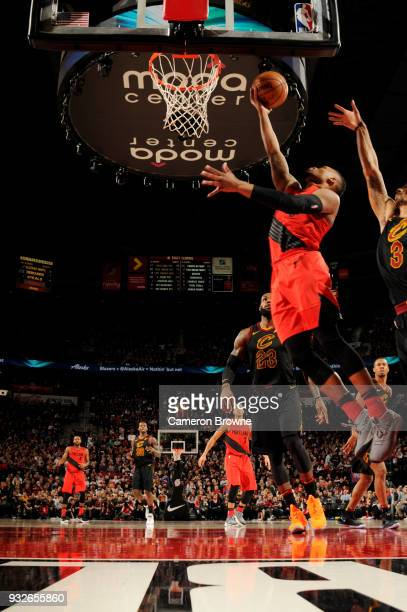 Damian Lillard of the Portland Trail Blazers goes to the basket against the Cleveland Cavaliers on March 15 2018 at the Moda Center in Portland...