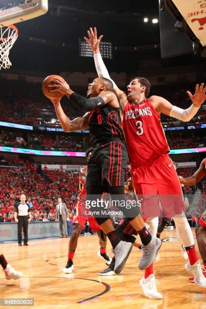 Damian Lillard of the Portland Trail Blazers goes to the basket against the New Orleans Pelicansin Game Three of Round One of the 2018 NBA Playoffs...