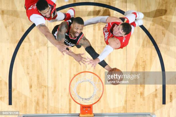 Damian Lillard of the Portland Trail Blazers goes to the basket against the New Orleans Pelicans in Game Four of Round One of the 2018 NBA Playoffs...