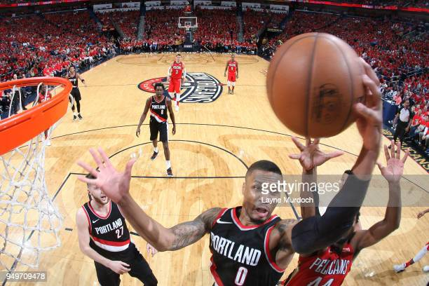 Damian Lillard of the Portland Trail Blazers goes up for a rebound against the New Orleans Pelicans in Game Four of Round One of the 2018 NBA...