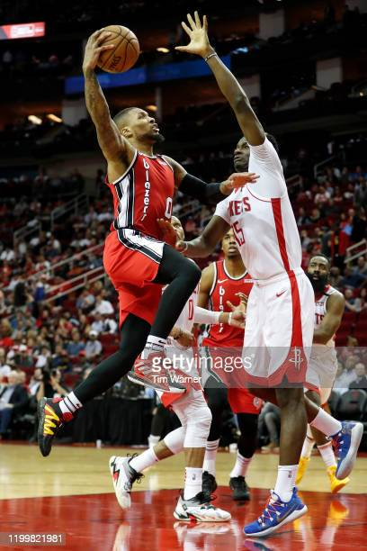 Damian Lillard of the Portland Trail Blazers goes up for a shot against Clint Capela of the Houston Rockets in the second half at Toyota Center on...