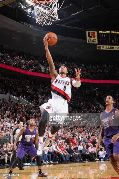 Damian Lillard of the Portland Trail Blazers goes up for the game winning shot against the Phoenix Suns on November 13 2013 at the Moda Center Arena...