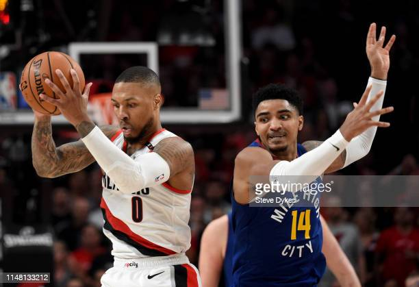 Damian Lillard of the Portland Trail Blazers grabs a ball in front of Gary Harris of the Denver Nuggets during the second half of Game Six of the...