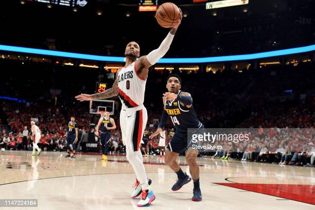 Damian Lillard of the Portland Trail Blazers grabs a inbounds pass in front of Gary Harris of the Denver Nuggets during the second half of game four...