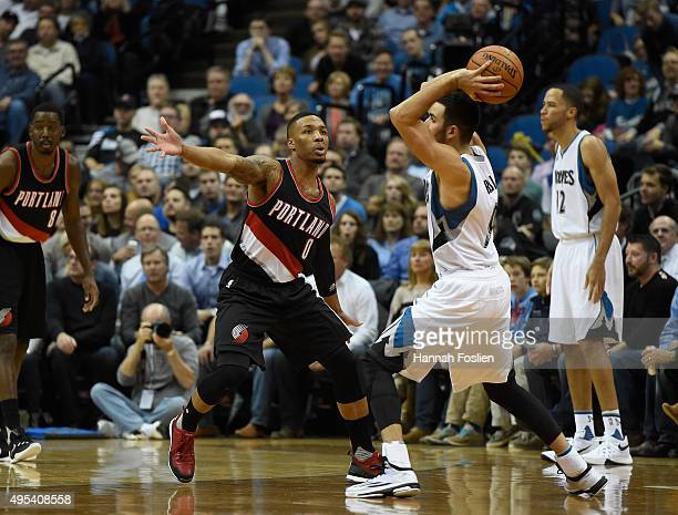 Damian Lillard of the Portland Trail Blazers guards against a pass from Ricky Rubio of the Minnesota Timberwolves during the first quarter of the...