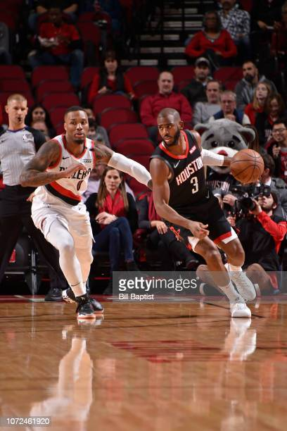 Damian Lillard of the Portland Trail Blazers guards Chris Paul of the Houston Rockets on December 11 2018 at the Toyota Center in Houston Texas NOTE...