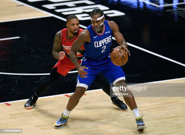 Damian Lillard of the Portland Trail Blazers guards Kawhi Leonard of the LA Clippers during the first half at Staples Center on December 30, 2020 in...