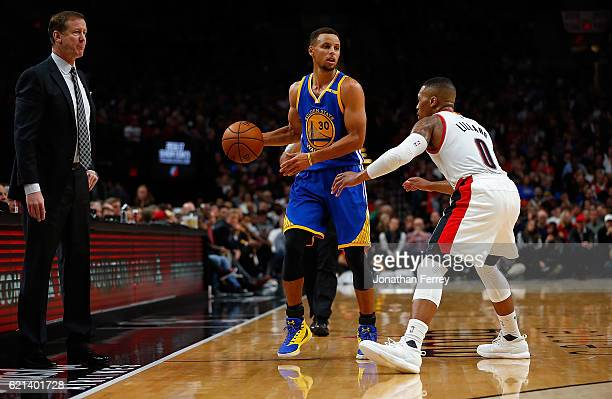 Damian Lillard of the Portland Trail Blazers guards Stephen Curry of the Golden State Warriors at Moda Center on November 1 2016 in Portland Oregon...