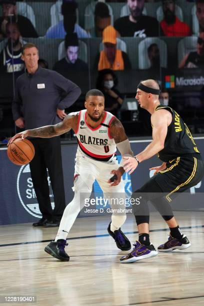 Damian Lillard of the Portland Trail Blazers handles the ball against the Los Angeles Lakers during Round One Game Four of the NBA Playoffs on August...