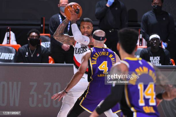 Damian Lillard of the Portland Trail Blazers handles the ball against the Los Angeles Lakers during Round One Game Three of the NBA Playoffs on...