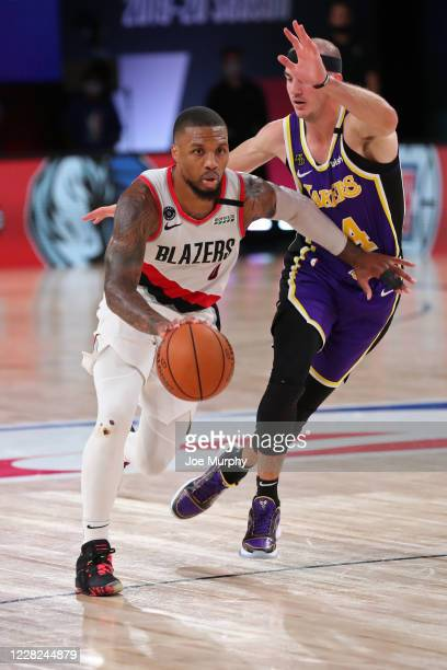 Damian Lillard of the Portland Trail Blazers handles the ball against the Los Angeles Lakers during Round One Game Three on August 22 2020 in Orlando...