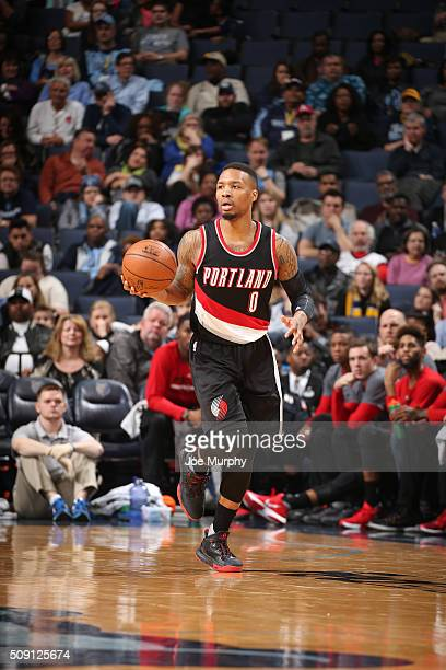 Damian Lillard of the Portland Trail Blazers handles the ball against the Memphis Grizzlies on February 8 2016 at FedExForum in Memphis Tennessee...