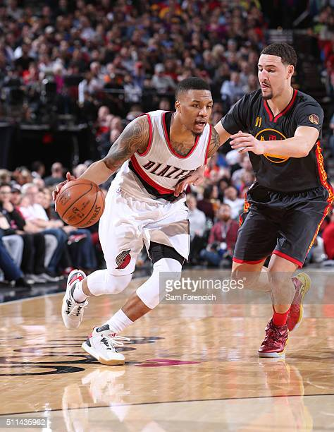 Damian Lillard of the Portland Trail Blazers handles the ball against Klay Thompson of the Golden State Warriors on February 19 2016 at the Moda...