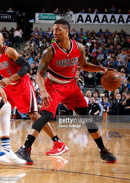 Damian Lillard of the Portland Trail Blazers handles the ball against the Dallas Mavericks on March 20 2016 at the American Airlines Center in Dallas...