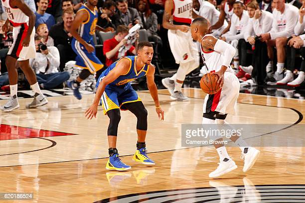 Damian Lillard of the Portland Trail Blazers handles the ball against Stephen Curry of the Golden State Warriors on November 1 2016 at the Moda...