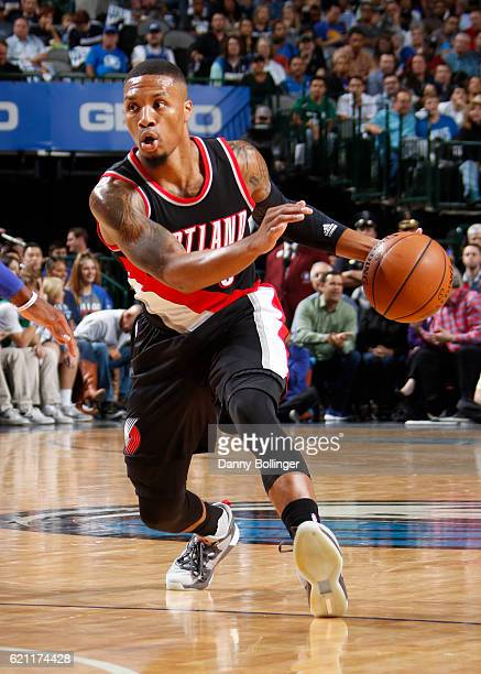 Damian Lillard of the Portland Trail Blazers handles the ball against the Dallas Mavericks on November 4 2016 at the American Airlines Center in...
