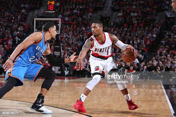 Damian Lillard of the Portland Trail Blazers handles the ball against Andre Roberson of the Oklahoma City Thunder during the game on December 13 2016...