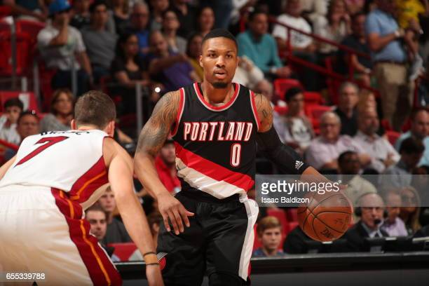 Damian Lillard of the Portland Trail Blazers handles the ball against the Miami Heat on March 19 2017 at AmericanAirlines Arena in Miami Florida NOTE...