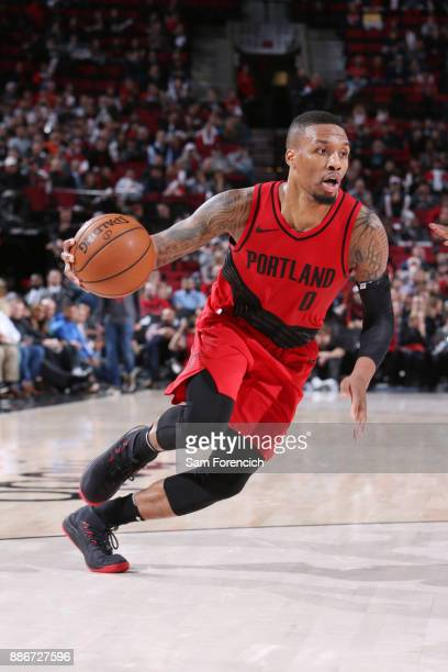 Damian Lillard of the Portland Trail Blazers handles the ball against the Washington Wizards on December 5 2017 at the Moda Center in Portland Oregon...