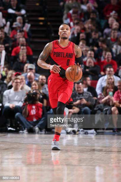 Damian Lillard of the Portland Trail Blazers handles the ball against the Houston Rockets on December 9 2017 at the Moda Center in Portland Oregon...