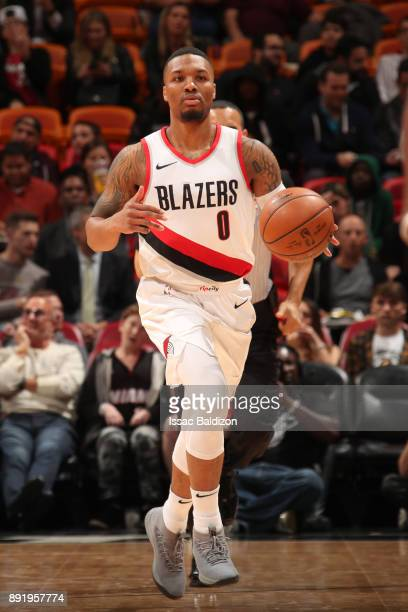 Damian Lillard of the Portland Trail Blazers handles the ball against the Miami Heat on December 13 2017 at American Airlines Arena in Miami Florida...