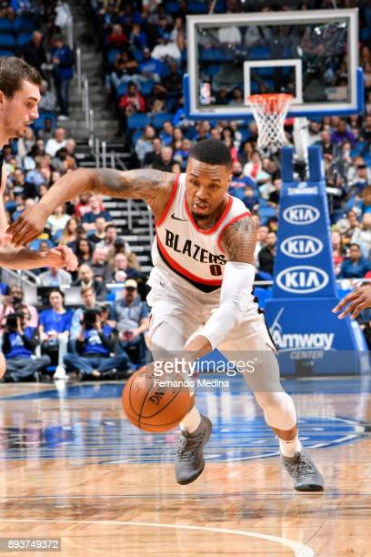 Damian Lillard of the Portland Trail Blazers handles the ball against the Orlando Magic on December 15 2017 at Amway Center in Orlando Florida NOTE...