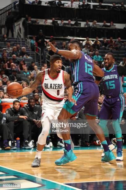 Damian Lillard of the Portland Trail Blazers handles the ball against the Charlotte Hornets on December 16 2017 at Spectrum Center in Charlotte North...