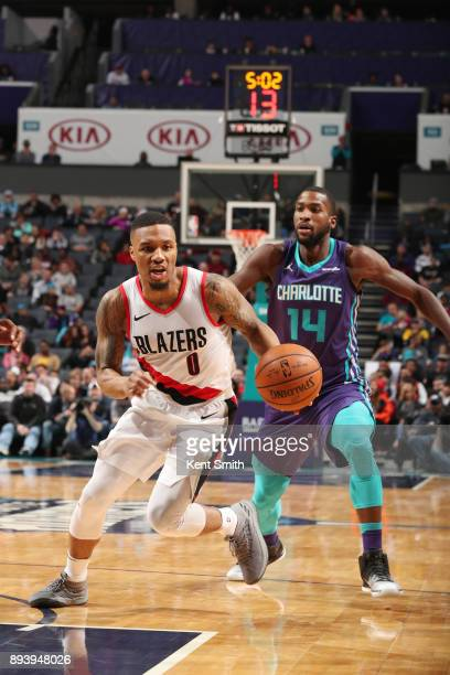 Damian Lillard of the Portland Trail Blazers handles the ball against Michael KiddGilchrist of the Charlotte Hornets on December 16 2017 at Spectrum...