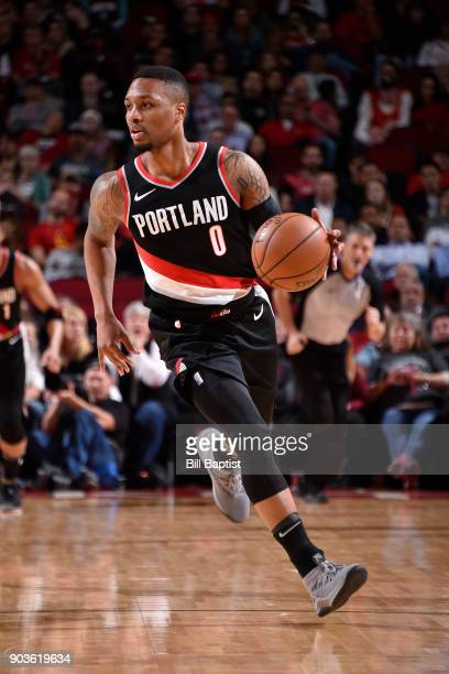 Damian Lillard of the Portland Trail Blazers handles the ball against the Houston Rockets on January 10 2018 at the Toyota Center in Houston Texas...
