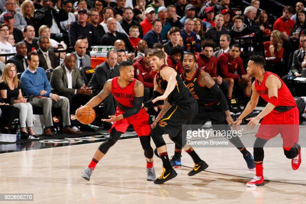 Damian Lillard of the Portland Trail Blazers handles the ball against the Cleveland Cavaliers on March 15 2018 at the Moda Center in Portland Oregon...