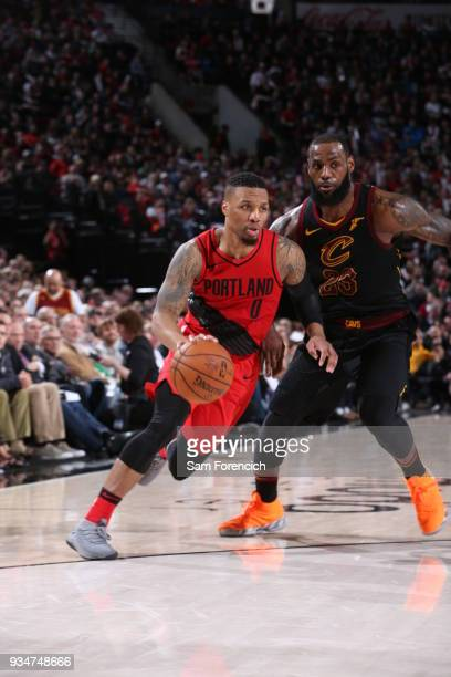 Damian Lillard of the Portland Trail Blazers handles the ball against LeBron James of the Cleveland Cavaliers on March 15 2018 at the Moda Center...