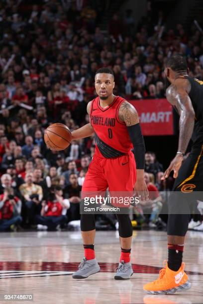 Damian Lillard of the Portland Trail Blazers handles the ball against the Cleveland Cavaliers on March 15 2018 at the Moda Center Arena in Portland...