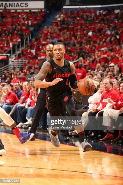 Damian Lillard of the Portland Trail Blazers handles the ball against the New Orleans Pelicans in Game Three of Round One of the 2018 NBA Playoffs on...