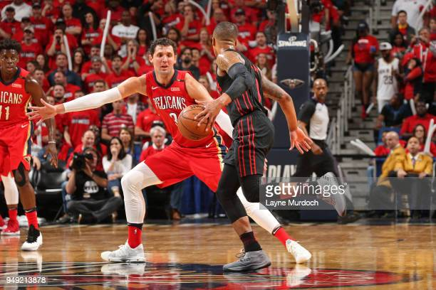 Damian Lillard of the Portland Trail Blazers handles the ball against Nikola Mirotic of the New Orleans Pelicans in Game Three of Round One of the...
