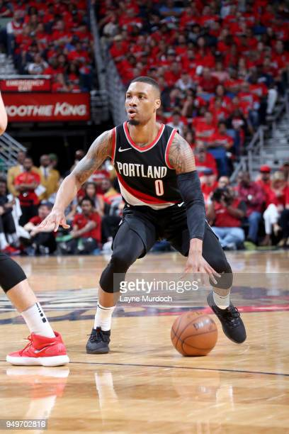 Damian Lillard of the Portland Trail Blazers handles the ball against the New Orleans Pelicans in Game Four of Round One of the 2018 NBA Playoffs on...