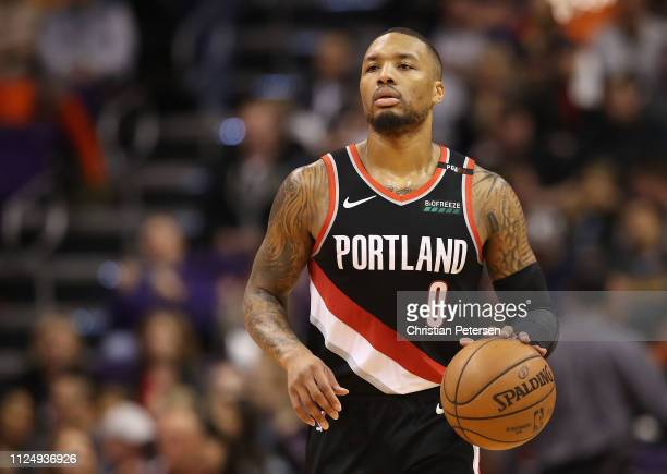 Damian Lillard of the Portland Trail Blazers handles the ball during the second half of the NBA game against the Phoenix Suns at Talking Stick Resort...