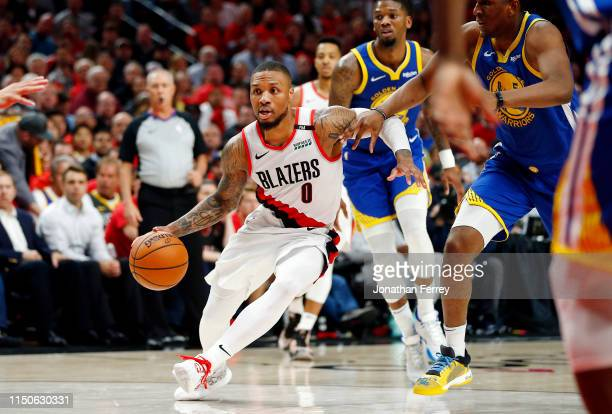 Damian Lillard of the Portland Trail Blazers handles the ball during the second half against the Golden State Warriors in game four of the NBA...