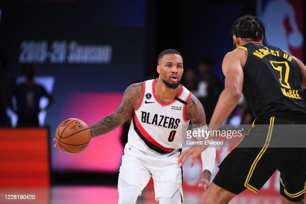 Damian Lillard of the Portland Trail Blazers handles the ball during the game against the Los Angeles Lakers during Round One Game Four of the NBA...