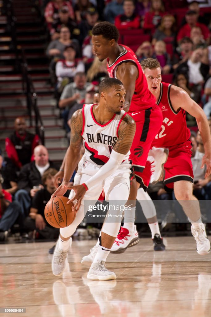 Damian Lillard #0 of the Portland Trail Blazers handles the ball during the preseason game against the Toronto Raptors on October 5, 2017 at the Moda Center Arena in Portland, Oregon.
