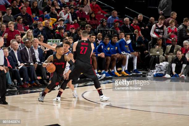 Damian Lillard of the Portland Trail Blazers handles the ball during the game against the Golden State Warriors on March 9 2018 at the Moda Center in...