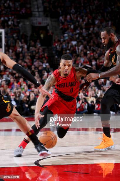 Damian Lillard of the Portland Trail Blazers handles the ball during the game against the Cleveland Cavaliers on March 15 2018 at the Moda Center in...