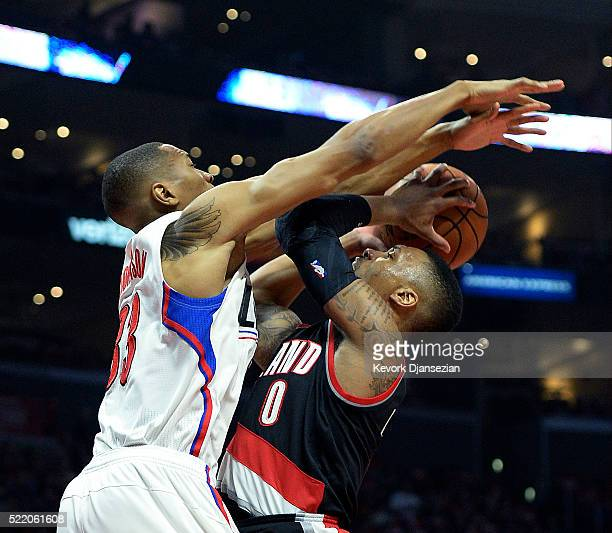 Damian Lillard of the Portland Trail Blazers has his shot blocked by Wesley Johnson of the Los Angeles Clippers during the first half in Game One of...