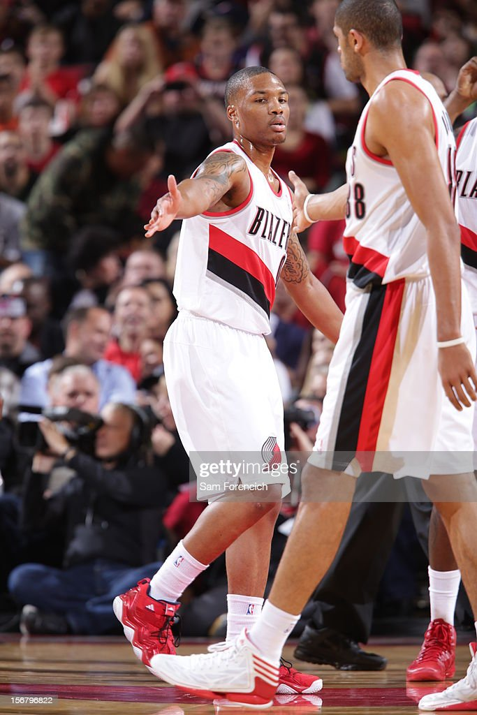 Damian Lillard #0 of the Portland Trail Blazers high fives teammate Nicolas Batum during the game against the Chicago Bulls on November 18, 2012 at the Rose Garden Arena in Portland, Oregon.
