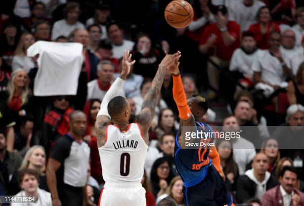 Damian Lillard of the Portland Trail Blazers hits a shot over Dennis Schroder of the Oklahoma City Thunder during the second half of Game Five of the...